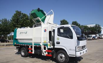 东风9方侧装挂桶垃圾车QTH5074ZZZA(带推板)
